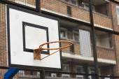 Basketball hopo and backboard in a housing estate — Stock Photo