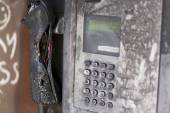 Vandalized pay phone, burnt and melted by arson — Stock Photo