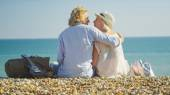 Young couple on a beach about to kiss on a bright sunny day — Stock Photo