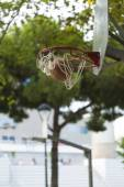 Basketball going through a hoop in a city park basketball court — Stock Photo