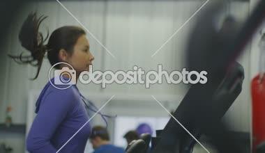 Woman runs along on a treadmill — Stock Video