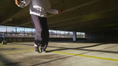 Jump roping energetically in sunlight — Stock Video