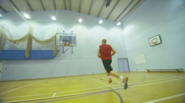 Basketball player running down the court and slam dunking — Stock Video