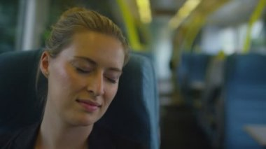 Woman on a train resting as it speeds — Stock Video