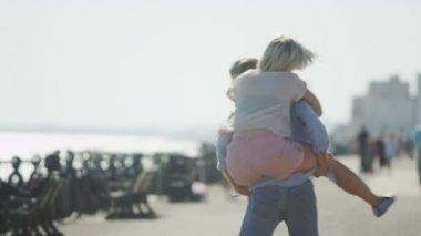 Couple having fun as the male piggy backs his girlfriend — Stock Video