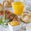 Continental breakfast: bread, croissant, coffee, jam, orange juice and butter — Stock Photo #64263433