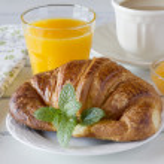 Continental breakfast: croissant, coffee, jam and orange juice — Stock Photo #64263593