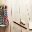 Back to school. A desk with supplies (pencils, notepad, eraser, etc.) — Stock Photo #64277647