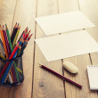 Back to school. A desk with supplies (pencils, notepad, eraser, etc.) — Stock Photo #64277733