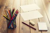 Back to school. A desk with supplies (pencils, notepad, eraser, etc.) — Stok fotoğraf