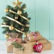 Some christmas gift boxes around the christmas tree — Stock Photo #64284269