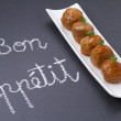 Delicious meatballs. Handwritten message in chalk: Bon appetit — Stock Photo #70319887