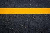 New asphalt texture with yellow line — Stock Photo