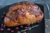 Baked meat with cranberries and thyme — Stock Photo