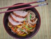 Buckwheat noodles with vegetables and duck — Stock Photo