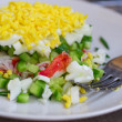 Salad of crab, cucumber, eggs and green onions. Soft focus — Stock Photo #69649977