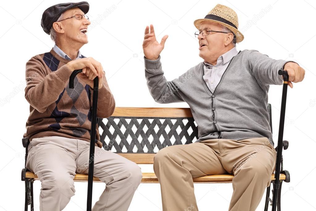 Ancianos Jubilados Sentados En Un Banco