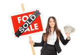 Realtor holding sign and money — Stock Photo