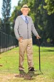 Senior with cane in park — Stock Photo