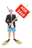Businessman with snorkel holding sign — Stock Photo