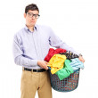 Young man holding laundry basket — Stock Photo #53800357