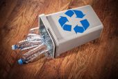 Recycle bin full of plastic bottles — Stock Photo