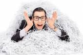 Man covered in pile of shredder paper — Stock Photo
