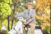 Senior gentleman on scooter in park — Stock Photo
