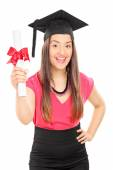 Overjoyed woman holding diploma — Stock Photo