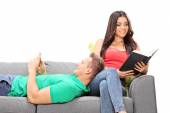 Peaceful couple relaxing on sofa — Stock Photo