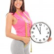 Woman holding big wall clock — Stockfoto #55477017