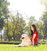 Girl on grass with dog — Stockfoto