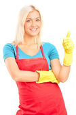 Cleaning lady giving thumb up — Stock Photo