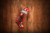Christmas stocking on wooden wall — Stock Photo