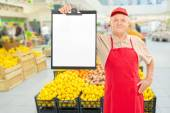 Market vendor holding clipboard — Stock Photo
