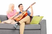 Guy playing guitar with girlfriend — Foto Stock