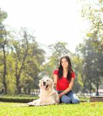 Girl in park with her dog — Stock Photo
