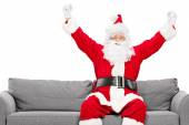 Santa Claus on sofa — Stock Photo
