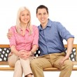 Young couple seated on bench — Stock Photo #60590439