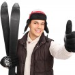 Постер, плакат: Man with pair of skis