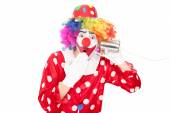 Clown with tin can phone — Stock Photo