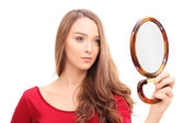 Gorgeous woman looking in a mirror — Stock Photo
