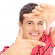 Man framing photo with hands — Stock Photo #66459693