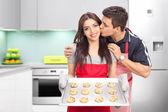 Couple baking cookies in kitchen — Stock Photo