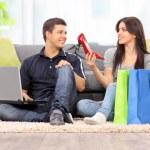 Woman showing shoes to boyfriend — Stock Photo #67599207