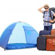 Baffled tourist standing by tent — Stock Photo #69327077
