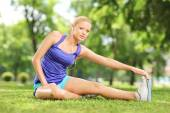 Active woman doing stretching exercises — Stock Photo