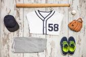Bunch of sportswear and baseball equipment — Stock Photo