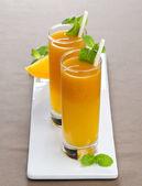 Pumpkin carrot juice with mint — Stock Photo