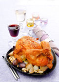 Baked chicken with onions garlic and wine — Stock Photo